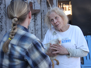 Judy Wood of Poultry Hollow Hatchery chats with a customer