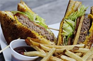 The Gimmie-Gimmie-Cheese Cheeseburger with hand cut fries.