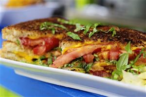 Grilled cheese with locally grown tomato and basil