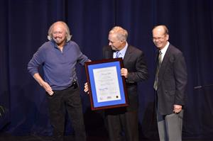 Barry Gibb is presented with the Inaugural Fellowship of the Center for Popular Music at MTSU by Ken Paulson (center), Dean of the College of Mass Communications, and Dr. Dale Cockrell (right), Director of the Center for Popular Music. (MTSU photo by Andy Heidt)