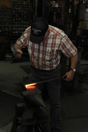 Joe Brown has hammered out thousands of metal leaves at his workshop near his home on Cripple Creek Road.
