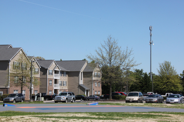 A cell tower hovers over an apartment complex on Lascassas Pike.