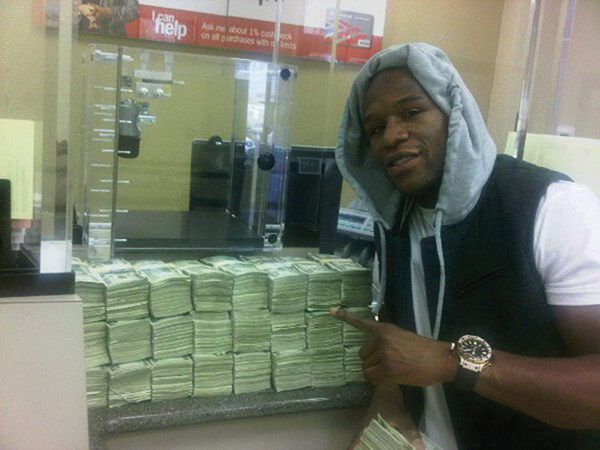 Floyd Mayweather with his money