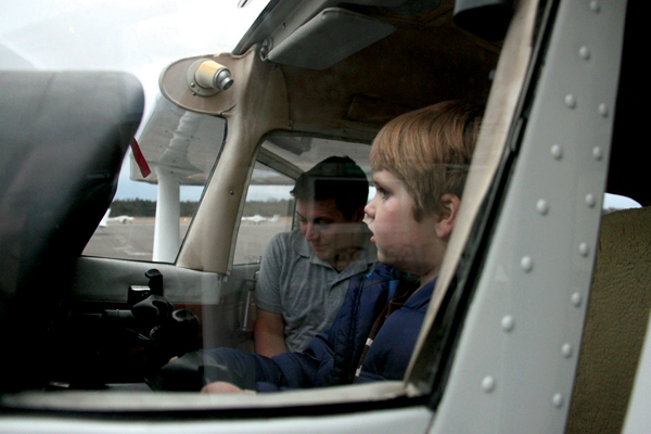 Pilot Victor Huey (left) with a curious 5-year-old co-pilot.