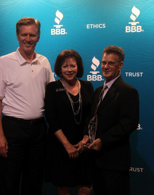Ken Moore, chairman of the BBB of Middle Tennessee (and the general manager at Beaman Dodge, Jeep, Chrysler) and Terrie Page, BBB branch manager,  congratulate Young on his 2016 award.