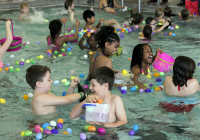 Participants in the Murfreesboro Parks and Rec.'s annual Underwater Easter Egg Hunt at Patterson Park Community Center scramble for the plastic eggs in the pool. photo by Jim Davis/Murfreesboro Parks & Rec.