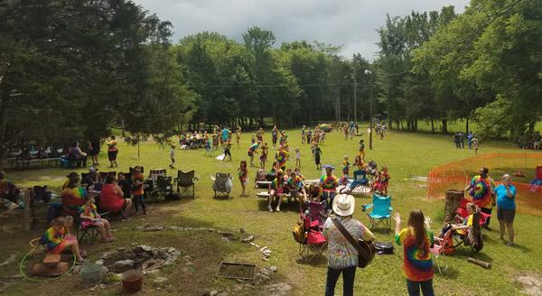 Camp volunteer Lynn Wilson leading Girl Scouts in 1960s music sing-a-longs.