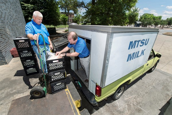 Matthew Wade, left, director of the MTSU Farm Laboratories, and Steve Dixon, new MTSU milk processing manager, delivering milk to campus locations and Hattie Jane's Creamery on the square in downtown Murfreesboro. (MTSU photo by Andy Heidt)